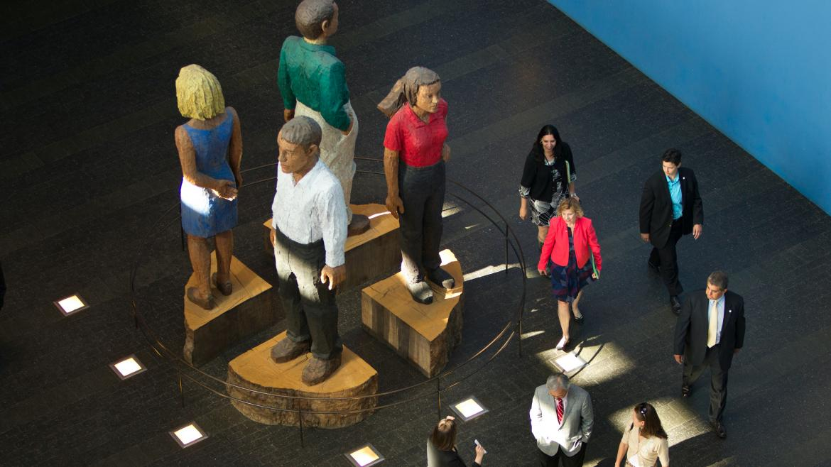 Large statues of people in the Rutter Center on the UCSF Mission Bay campus