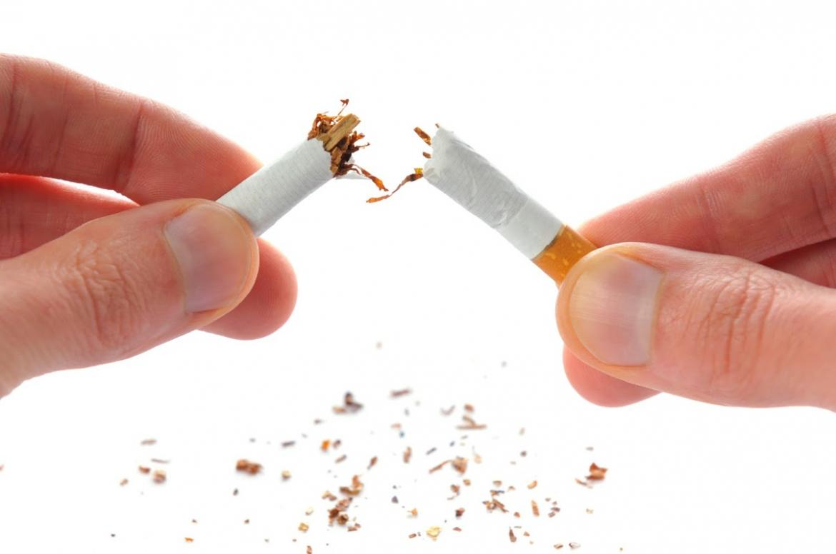 Cigarette being snapped in half