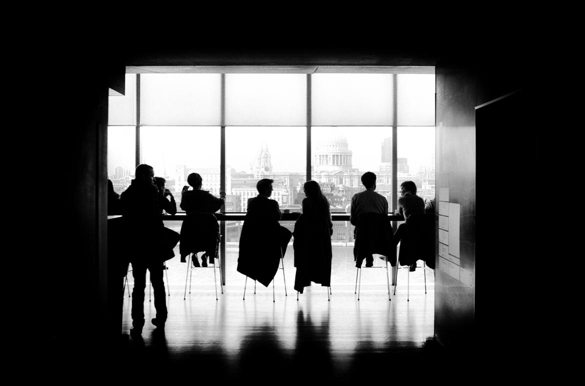 Silhouettes of people in a meeting