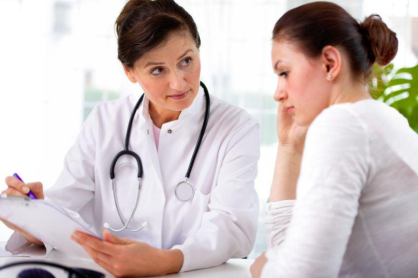 Female physician talking to a patient