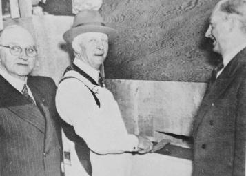 Porter Olson and Sproul lay the corner stone